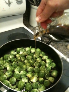 Step 2: add sprouts cut side down and drizzle more oil on top